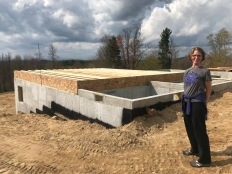 My wife, Kim, and the foundation for our home.